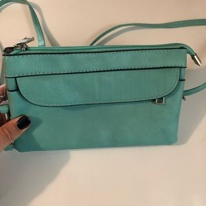 Turquoise clutch/ crossbody bag. Never worn